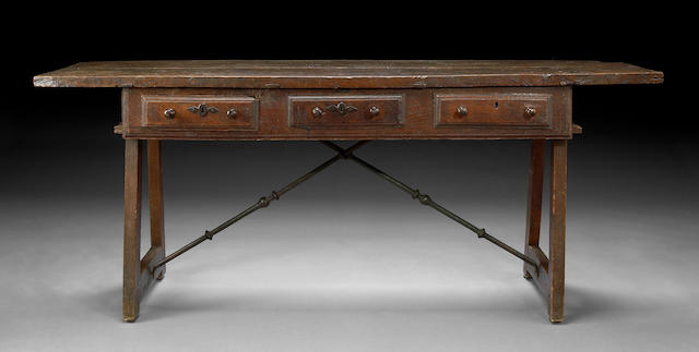 A Spanish Baroque walnut and oak library table