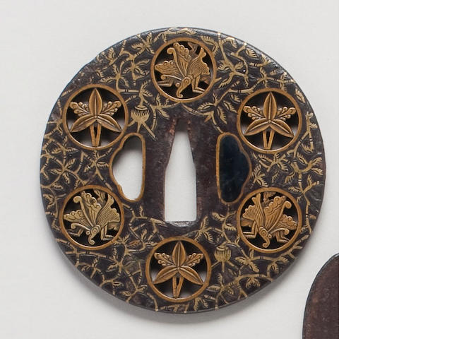 A good Yoshiro school iron and sentoku mon-sukashi tsuba Late 16th/17th Century