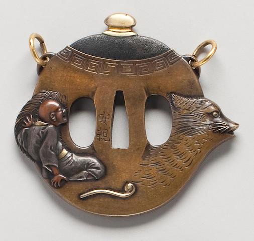 A kinko sentoku, shibuichi, shakudo and copper tsuba in the form of a badger tea kettle By Yasuchika