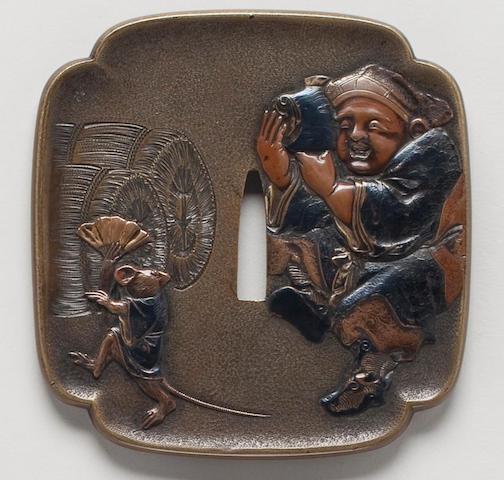 A mokko kinko takazogan tsuba By Inabanosuke Terusuke, Meiji Period
