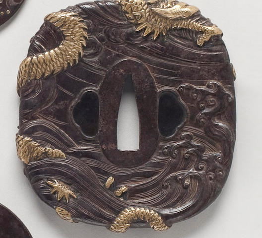 A nadakakugata iron and sentoku tsuba in the manner of Mito Tomoyoshi   Circa 1800