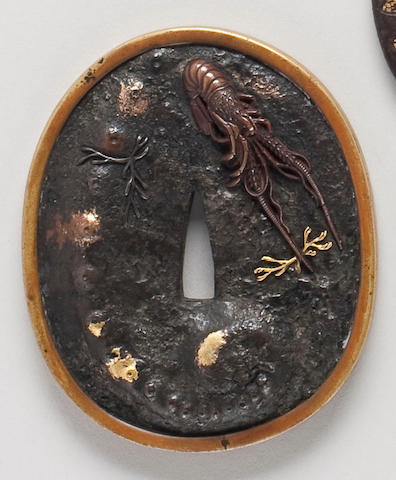 An unusual iron, sentoku, copper and gilt tsuba in the form of an awabi shell By Shokesai Toshikazu, Circa 1800