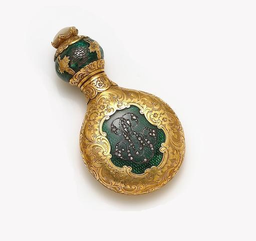 A gilt, enamel and diamond perfume bottle