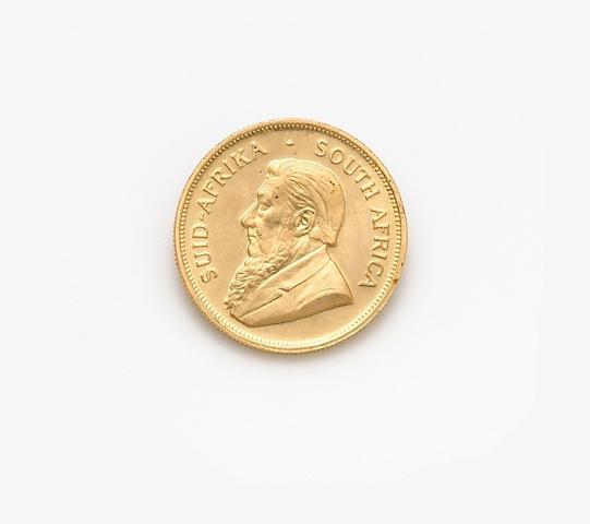 A gold Krugerrand Coin,