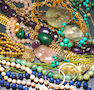 A miscellaneous collection of gem-set, paste, gold, silver and metal jewelry
