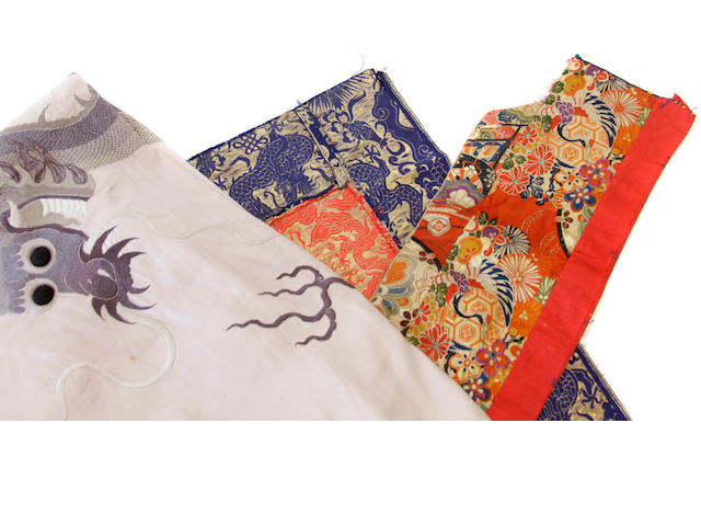 Two Chinese textiles including a rose satin ground embroidered dragon hanging