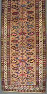 A Northwest Persian runner size approximately 3ft. 10in. x 13ft. 9in.