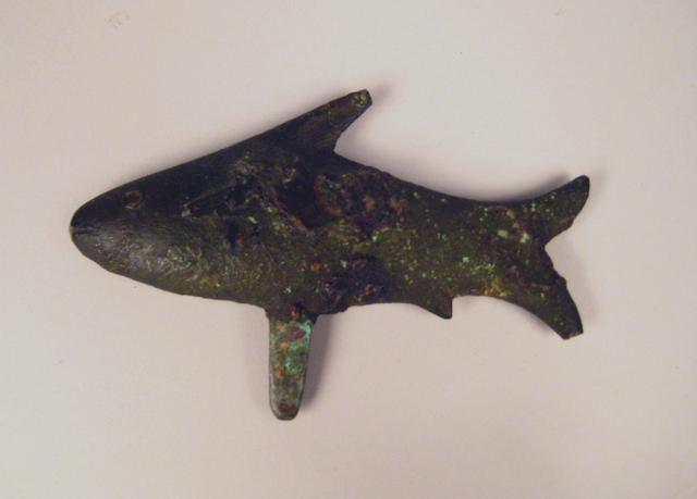 An ancient cast fish sculpture