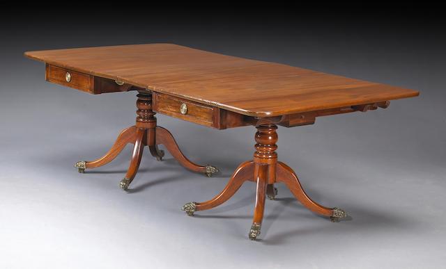 A Regency double pedestal mahogany dining table