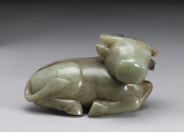 A carved nephrite figure of a recumbent ram