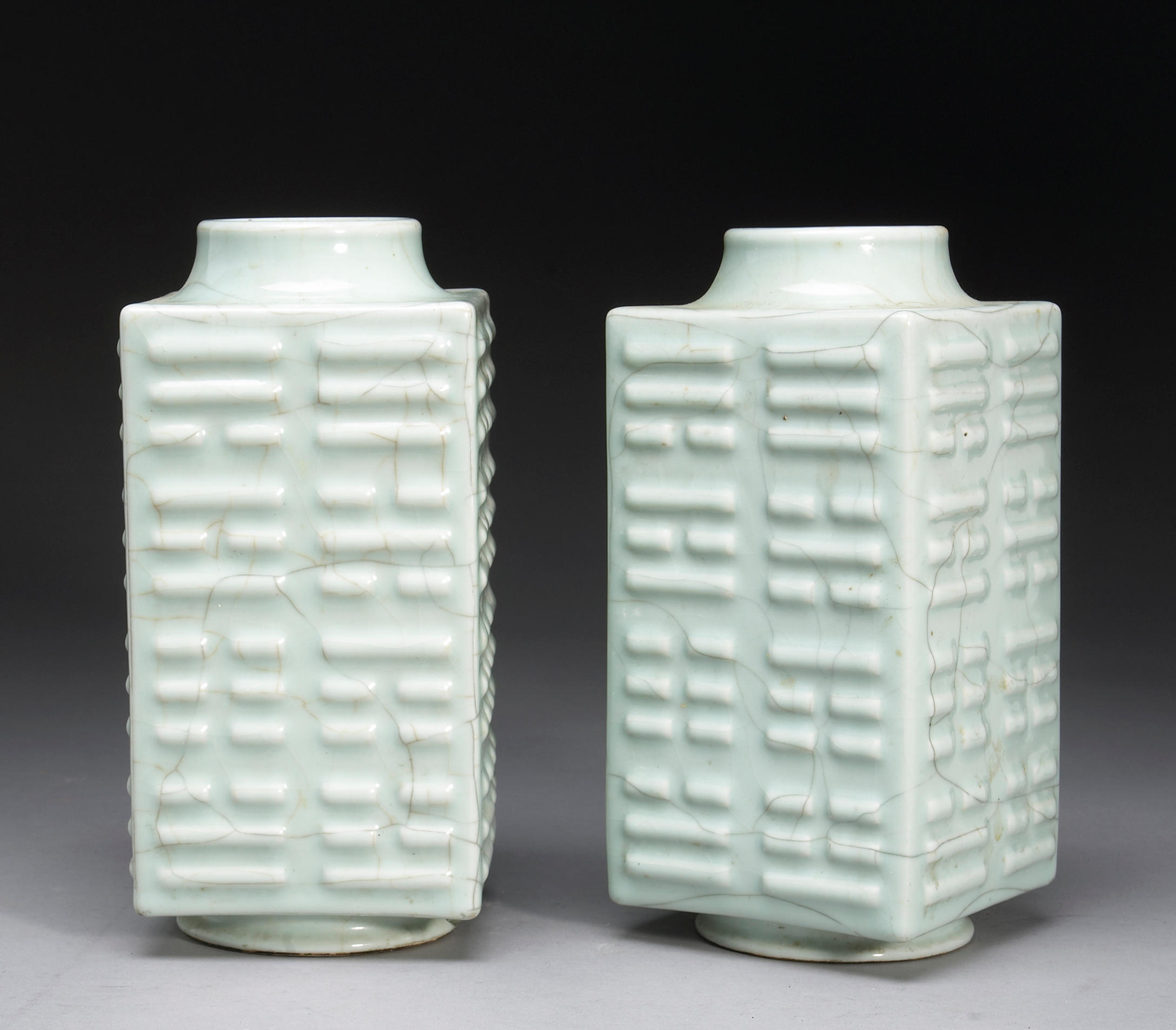 A pair of celadon crackle glazed cong-form vases