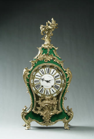 A Louis XV style bronze-mounted green painted mantel clock