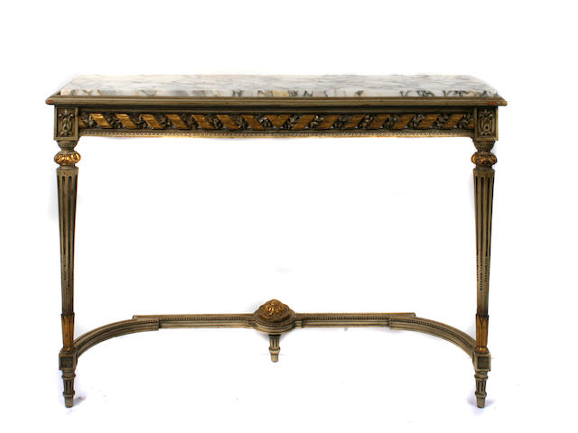 A Louis XVI style parcel gilt and paint decorated marble topped console table