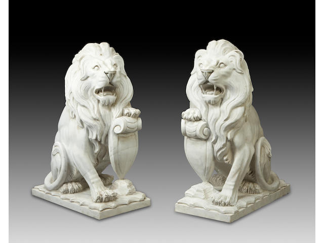 A pair of Neoclassical style carved marble models of lions