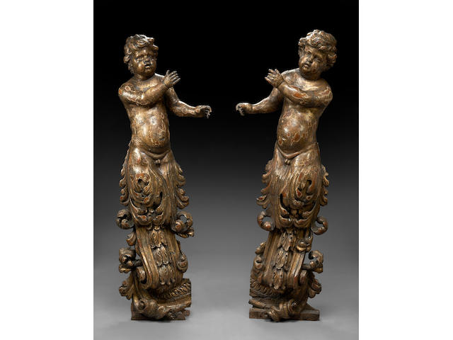 A pair of Italian carved giltwood figural terms