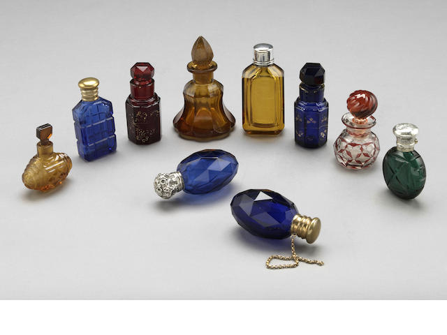 A group of ten colored glass scent bottles