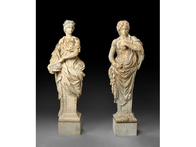 A pair of Neoclassical style carved granite figures