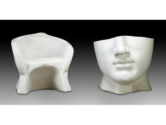 A pair of whimsical carved marble garden seats