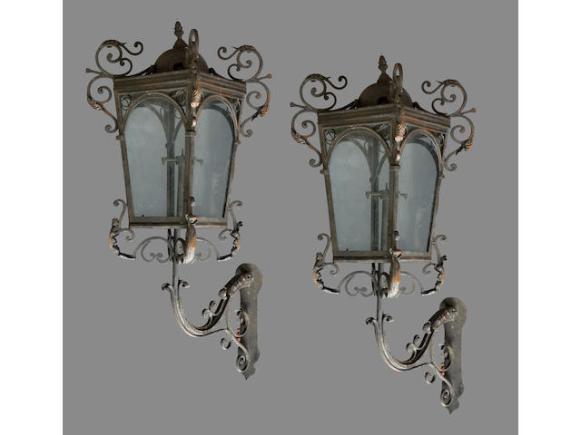 An imposing pair of Neoclassical style wrought iron and tole wall lanterns