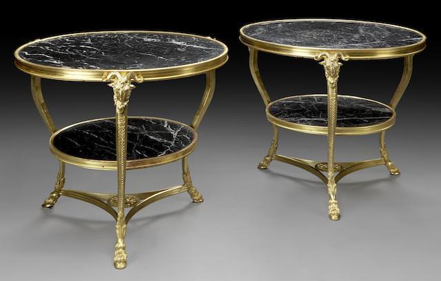 A pair of Directoire style gilt-bronze gueridons