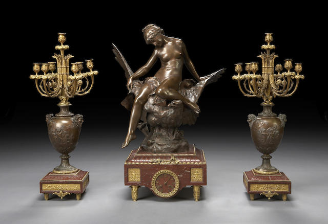 A fine Louis XVI style patinated bronze and rouge marble three-piece clock garniture