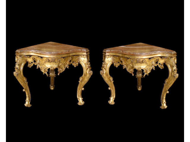 A bold pair of Italian Baroque giltwood consoles with Igiziano alabaster tops