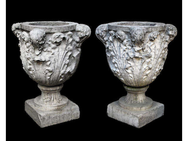 A fine pair of Italian Baroque Istrian marble urns on pedestals