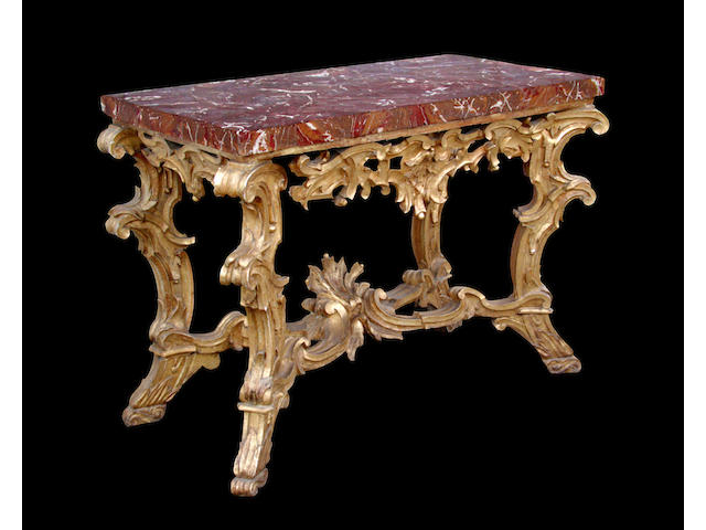 A superb Italian Baroque giltwood console with Sicilian jasper veneered top
