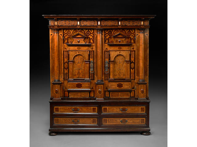 A Continental Baroque marquetry inlaid cupboard