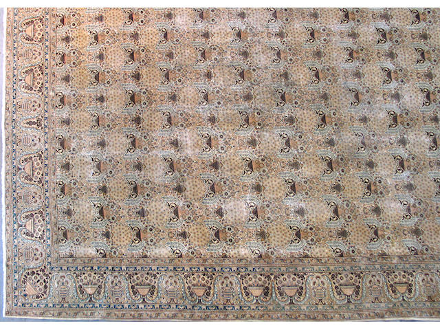A Tabriz carpet size approximately 9ft. 2in. x 12ft. 6in.