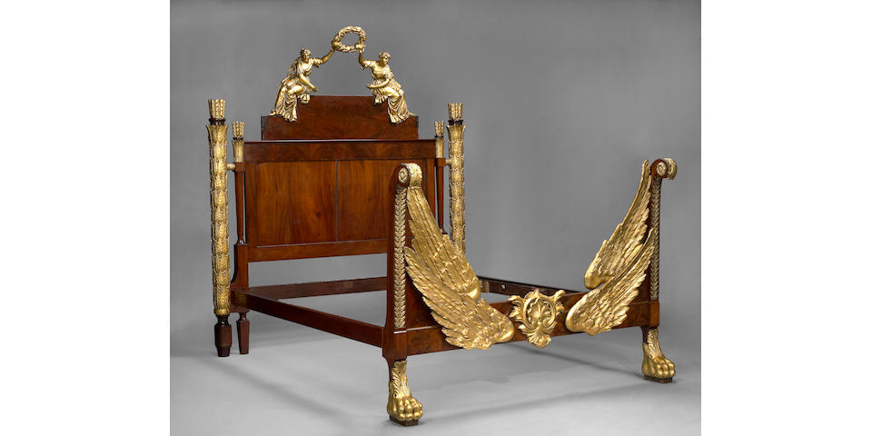 An imposing Neoclassical style parcel gilt mahogany bed