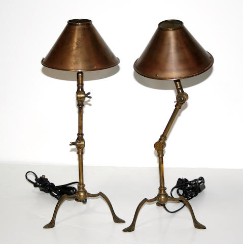 A pair of French brass adjustable desk lamps