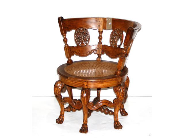 Two similar Anglo Indian caned hardwood chairs