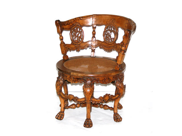 A pair of Anglo Indian caned hardwood chairs
