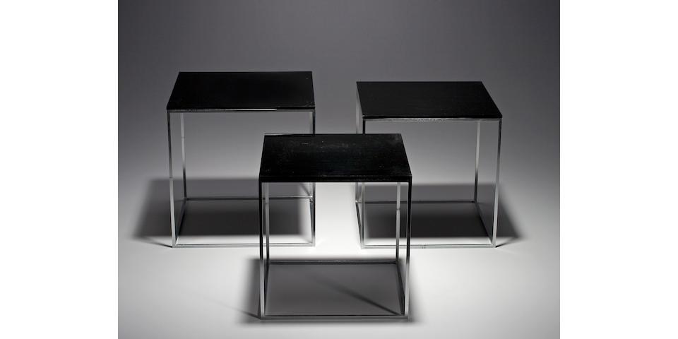 A set of three Poul Kjærholm chrome-plated steel and black acrylic nesting tables