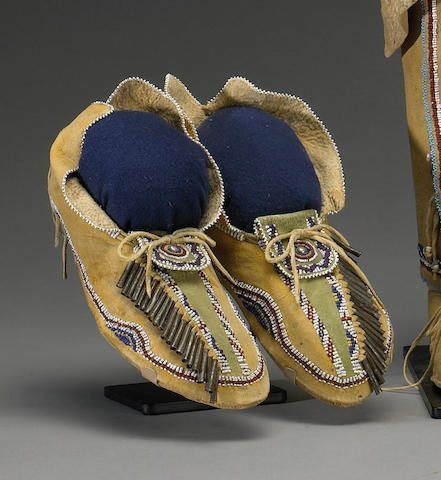 A pair of Kiowa/Comanche beaded moccasins
