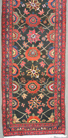 A Malayer runner Central Persia, size approximately 3ft. 3in. x 12ft. 3in.