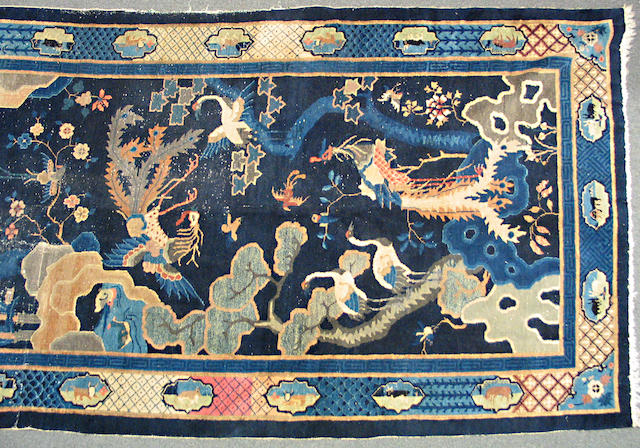A Chinese carpet size approximately 6ft. x 11ft. 5in.