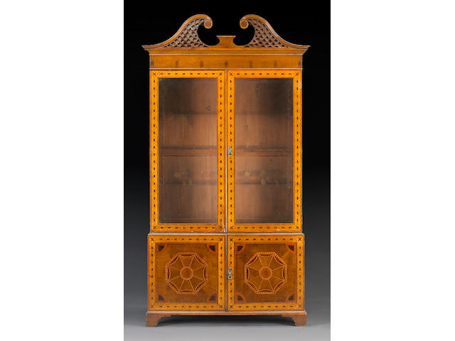 A pair of George III style inlaid walnut bookcase cabinets