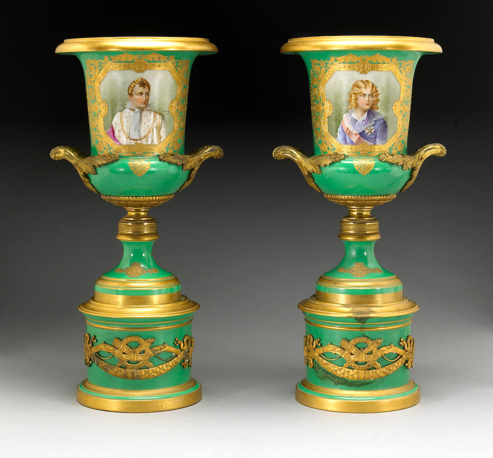 A pair of Sèvres style gilt bronze mounted porcelain urns
