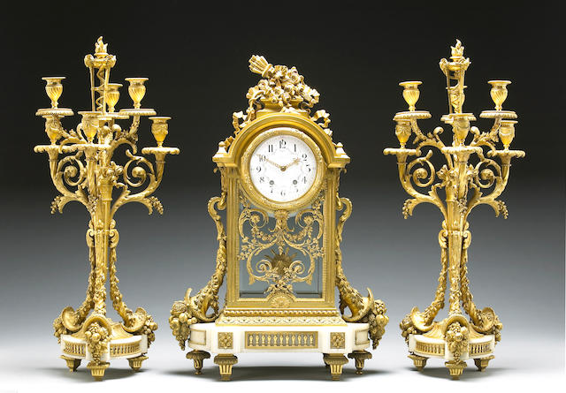 A very fine Louis XVI style gilt bronze and marble three piece clock garniture