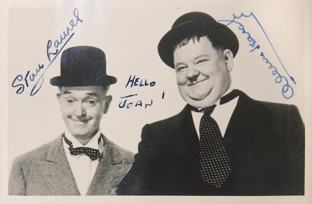 A Laurel and Hardy signed black and white photograph, 1940s