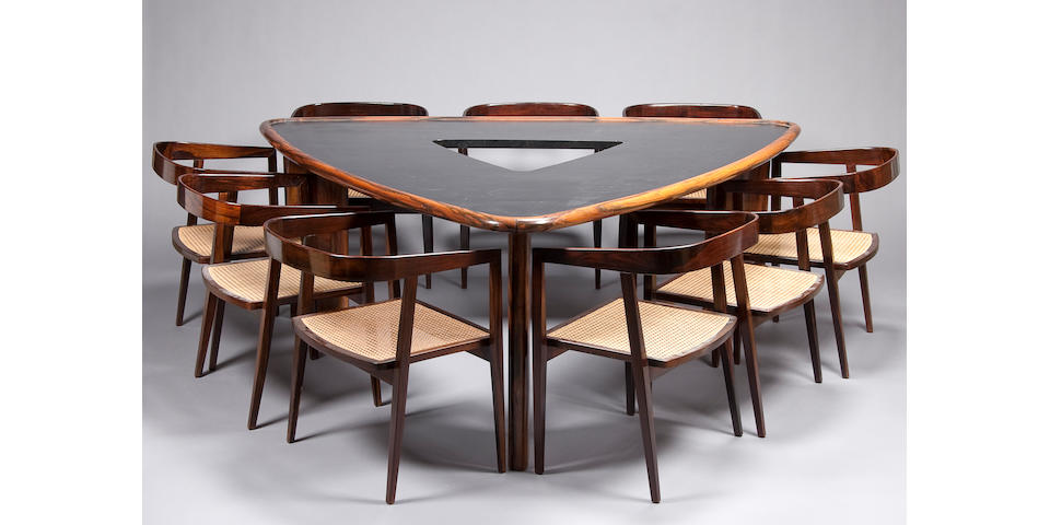 A fine Joaquim Tenreiro rosewood dining table and nine rosewood armchairs