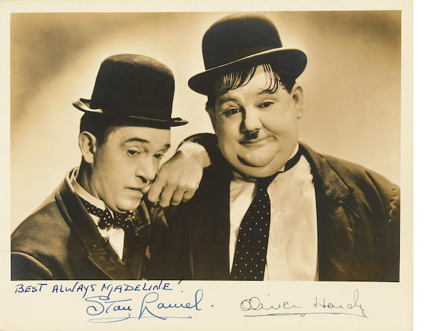 A Laurel and Hardy signed photograph with original transmittal envelope, 1930s