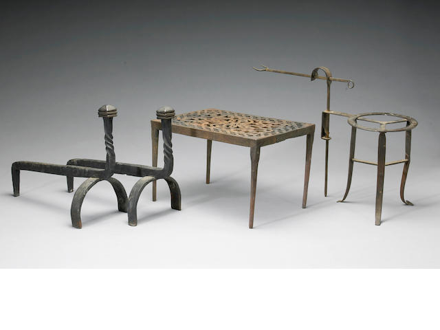 An assembled group of gilt bronze or iron fireplace accessories