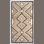 A Navajo rug, 7ft 3in x 3ft 10in