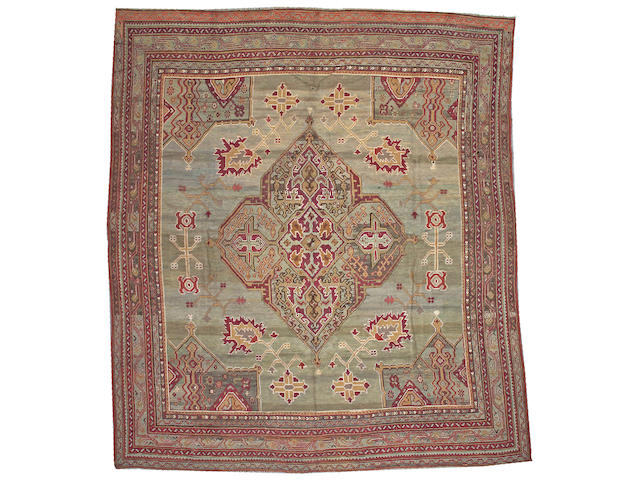 An Oushak carpet West Anatolia, size approximately 11ft. 5in. x 13ft. 2in.