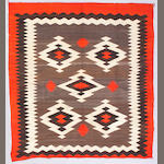 A Navajo rug, 7ft 4in x 6ft 9in