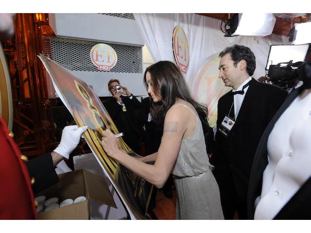 Brad Pitt and Angelina Jolie autographed 2009 Golden Globe® poster