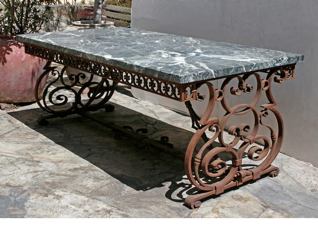 An Italian Baroque style verde antico marble and wrought iron garden table